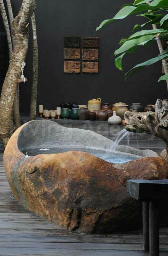 outdoor stone bath tub