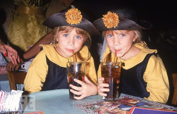 This is an image of the Olsen twins drinking just to seal the happiness deal